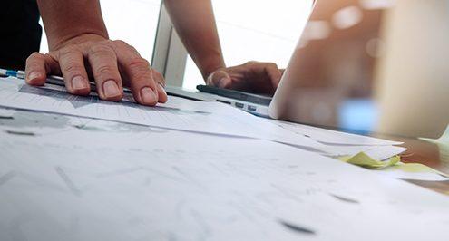 desktop-paper-laptop-hand