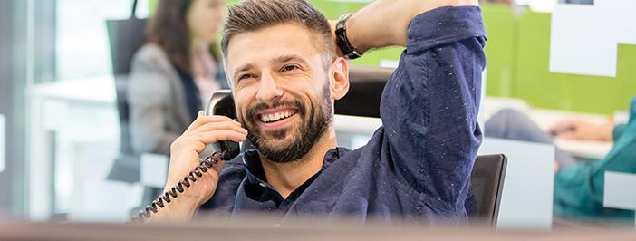 Happy guy talking on phone