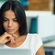 woman with laptop in office