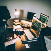 Hooded Hacker On Phone Scam
